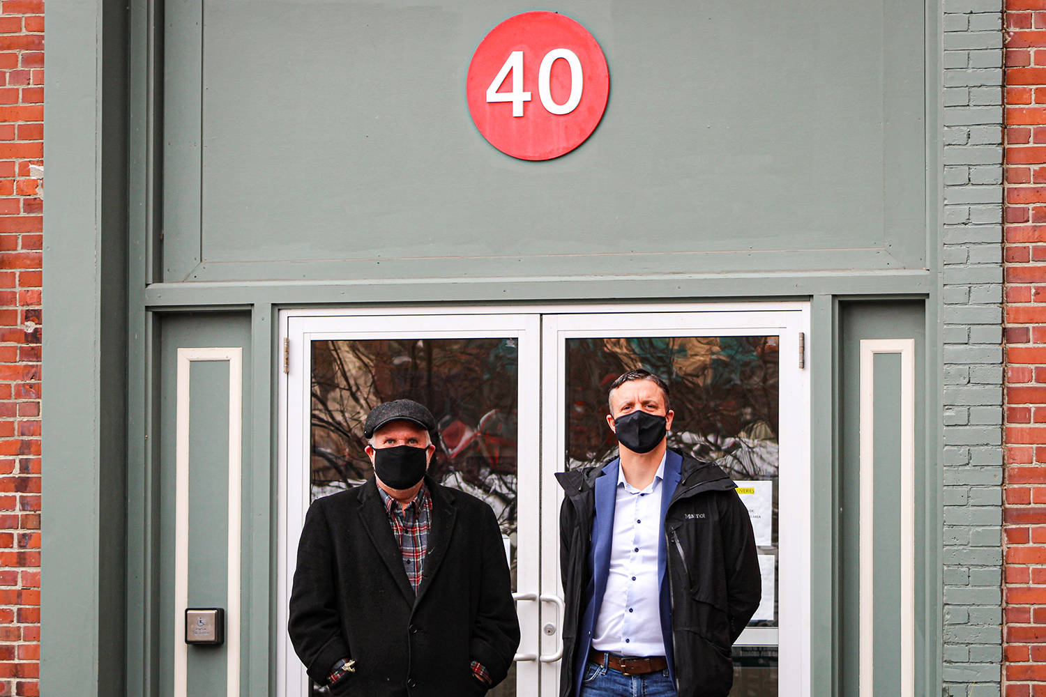 Lee Umphrey (left) and Philip Henry, pictured on Dec. 22, the day Henry purchased 40 Harlow St. from Eastern Maine Development Corporation. Credit: Courtesy of EMDC